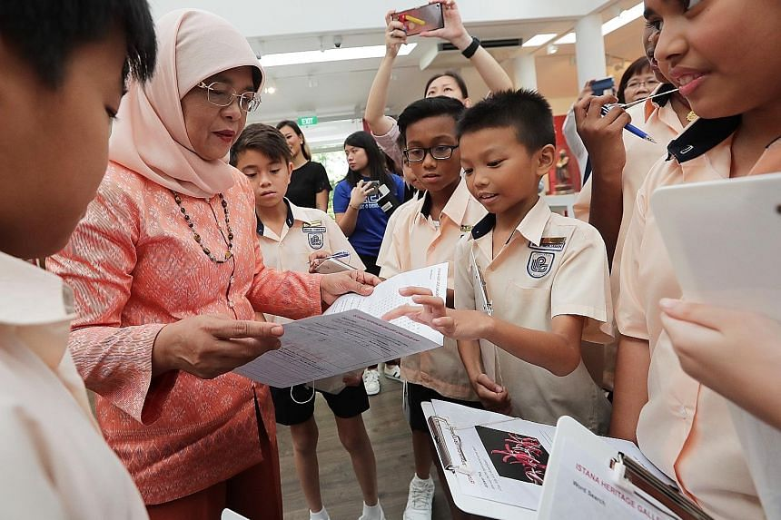 President Halimah Yacob meeting Loyang Primary School pupils, who are among 228 students from primary and secondary schools taking part in the first Istana Heritage Gallery Challenge. Participants have to answer quizzes about the heritage and