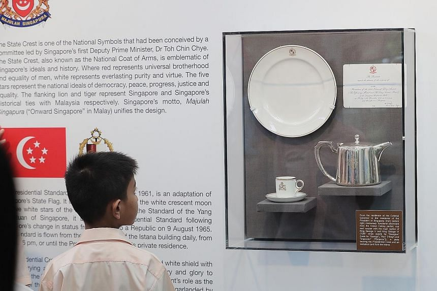 President Halimah Yacob (left) meeting Loyang Primary School pupils, who are among 228 students from primary and secondary schools taking part in the first Istana Heritage Gallery Challenge. Participants have to answer quizzes about the heritage and