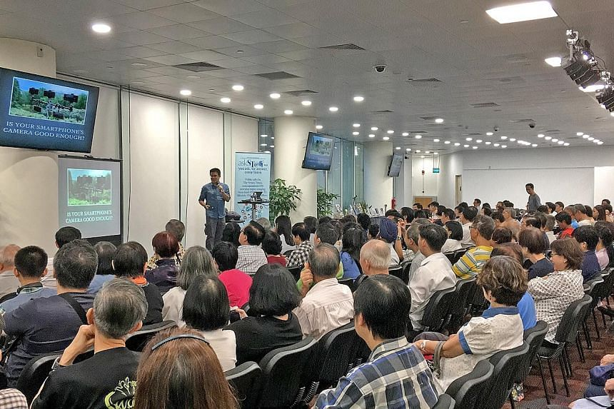 The Straits Times deputy tech editor Trevor Tan's talk at the National Library at Victoria Street was attended by around 200 people, many curious to know his opinion on which camera was a good one.