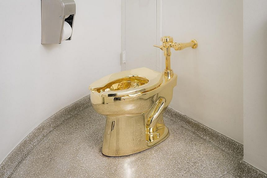 """Italian artist Maurizio Cattelan's """"America"""" - a gleaming gold toilet - was on display at the Guggenheim for nearly a year. The museum's chief curator has refused the White House's request for a Van Gogh painting to decorate the US President's privat"""