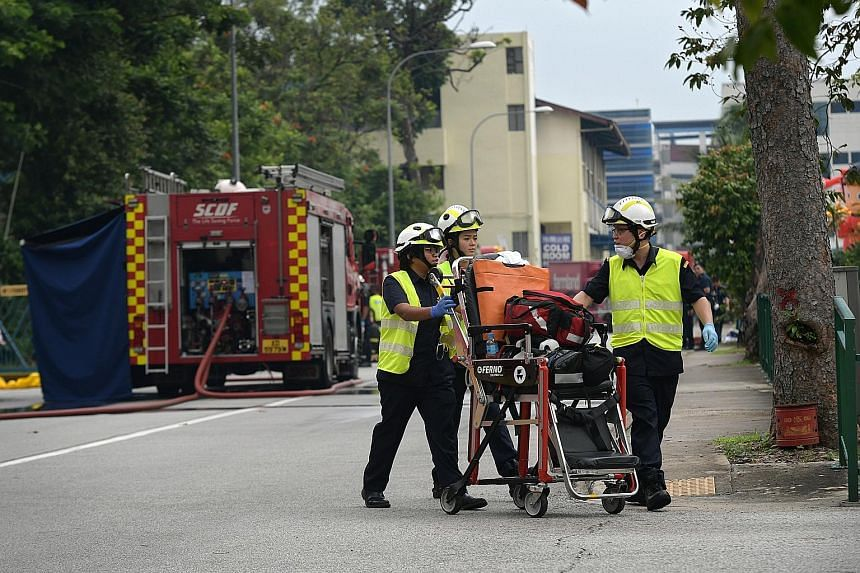 SCDF personnel at the scene of the ammonia gas leak in a building in Fishery Port Road. About 100 workers had to be evacuated from the premises.