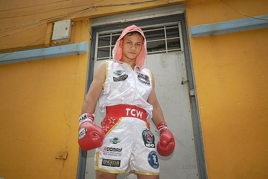 Muhamad Ridhwan won three professional boxing titles last year, most notably the IBO International super featherweight title in October.
