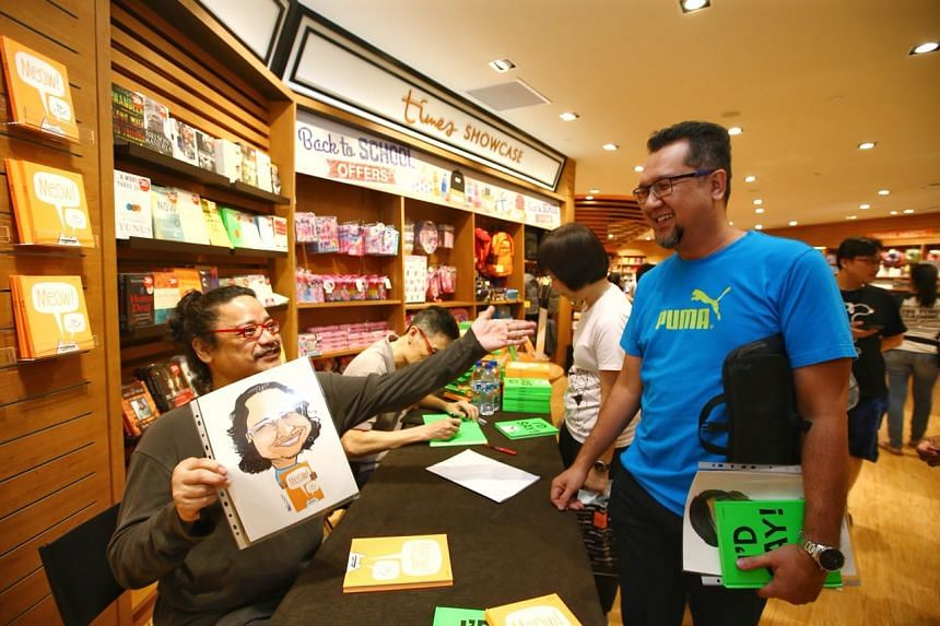 Mr Mat Tocang gives Miel and Lee Chee Chew each a caricature of themselves at the meet-and-greet at Times Waterway.