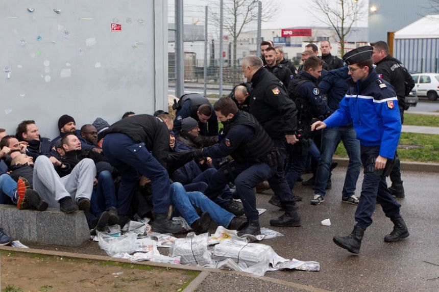 Prison wardens are grouped together by French gendarmes as they block the Lyon-Corbas jail near Lyon during a nationwide protest, in France, on Jan 22, 2018.