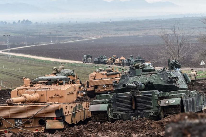 Turkish tanks are parked near the Syrian border at Hassa, in Hatay province on Jan 24, 2018, as part of the operation Olive Branch, supporting Syrian rebels with ground troops, air strikes and artillery fire.