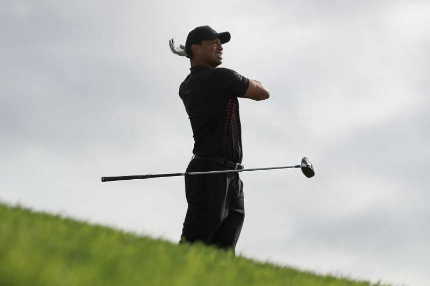 Tiger Woods reacts after playing his shot from the 12th tee during the first round of the Farmers Insurance Open at Torrey Pines South on Jan 25, 2018 in San Diego, California.