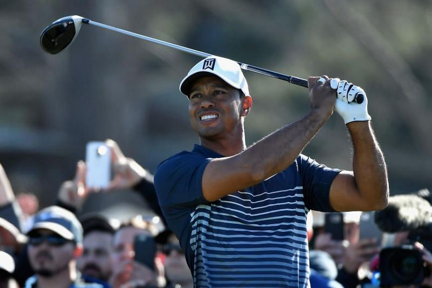 Tiger Woods plays his shot from the 13th tee during the second round of the Farmers Insurance Open at Torrey Pines North on Jan 26, 2018 in San Diego, California.