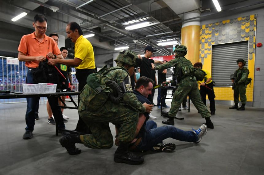 A member of the public tried to force his way out and was apprehended. Soldiers from 3rd Battalion, Singapore Infantry Regiment (3 SIR) conducted cordon and search operations together with Singapore Police Force officers and Sports Hub security offic