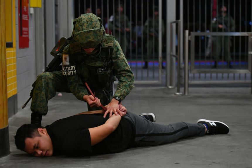 A suspect armed with a knife being apprehended. Soldiers from 3rd Battalion, Singapore Infantry Regiment (3 SIR) conducted cordon and search operations together with Singapore Police Force officers and Sports Hub security officers.