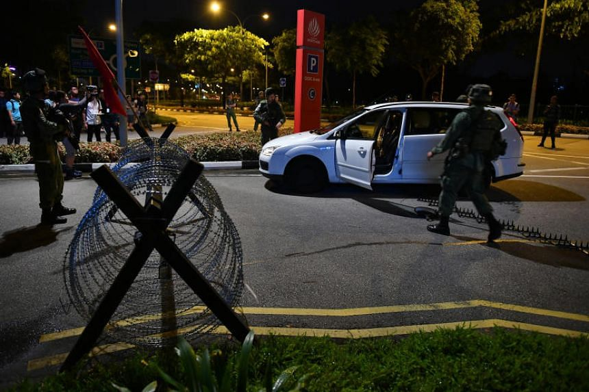 Soldiers doing a vehicular search after a car tried to enter Singapore Sports Hub by force and was stopped by soldiers from the 3rd Battalion, Singapore Infantry Regiment (3 SIR).