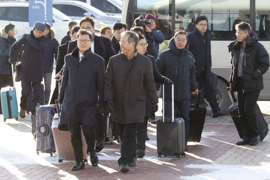 The South Korean delegation leave for North Korea at the immigration office in Goseong, Gangwon, South Korea, on Jan 23, 2018.