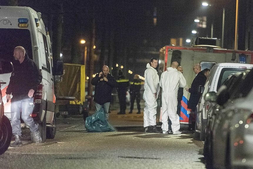 Policemen investigating a shooting at the Grote Wittenburgstraat in Amsterdam, Netherlands, on Jan 26, 2018.