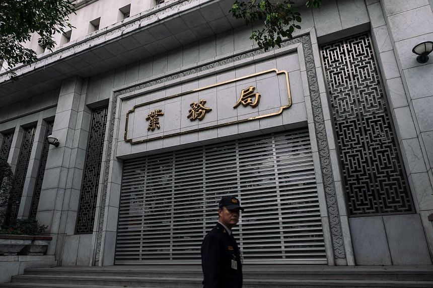 A security officer walks past the Taiwan Central Bank headquarters building in Taipei.