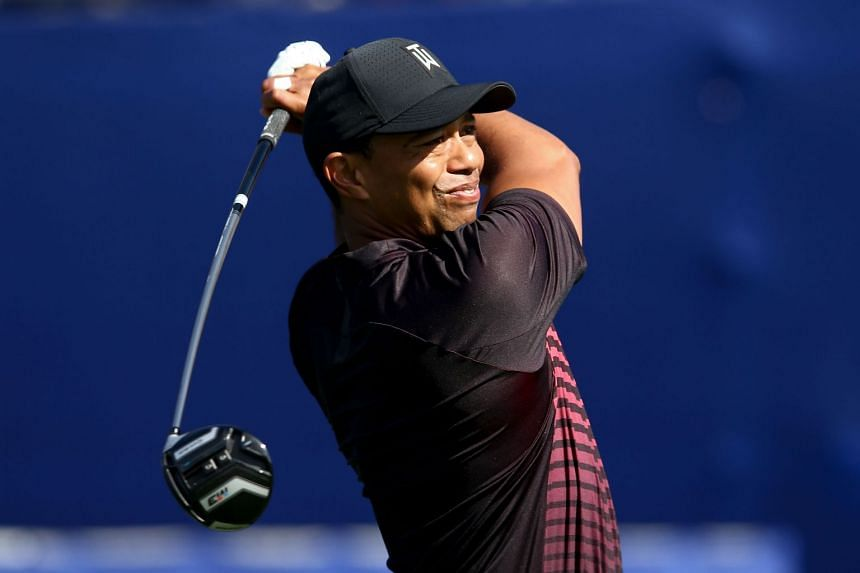 Tiger Woods plays his shot from the seventh tee during the first round of the Farmers Insurance Open.