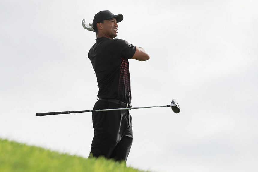 From top: A theatrical Tiger Woods dropping his club in disgust and groaning loudly at the 12th tee, but the TV cameras cut back to a chuckling Woods, when the ball travelled 316 yards and found the middle of the fairway. The former world No. 1 looki