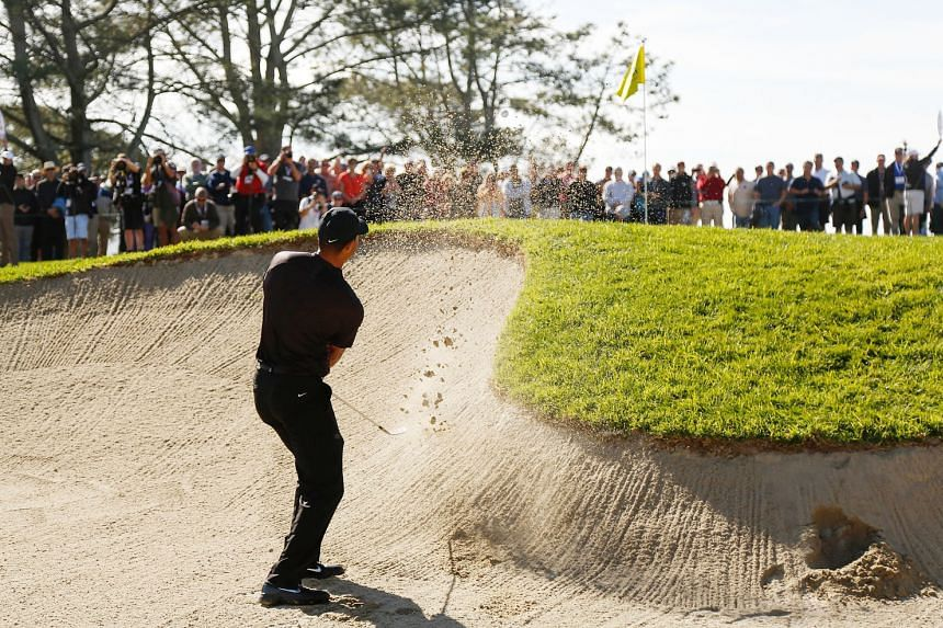 The 14-time Major champion playing a shot from a bunker on the first hole, where he failed to hit the fairway and green and ended up with a bogey five.
