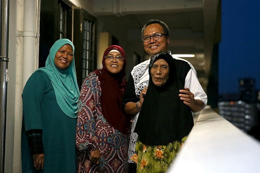 Left: Mr Mohamed Nassir Ismail with his nieces (from left) Sarah Hamid and Sarinah Hamid, and cousin Maimunah Ahmad. More than 50 of his relatives live in the same HDB blocks in Upper Boon Keng Road. Right: History teacher Mohamed Shahrom Mohamed Tah