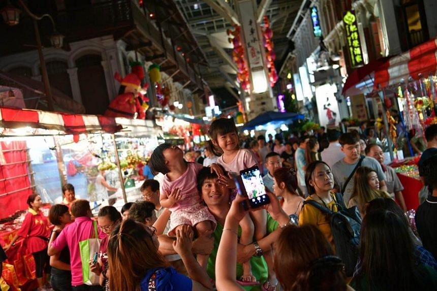 Large crowds shopping at the bazaar in Chinatown on Jan 26, 2017.