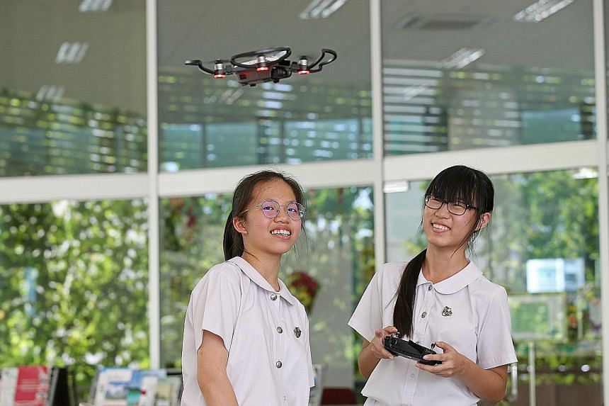 Chong Zhi Yu (left), 16, and Koh Si Siang, 12, work with a micro:bit. Learning to program the tiny computers is a new part in the school's iSCoRe2 curriculum. A student experimenting with virtual reality technology at Anglican High's iCrea+e corner i