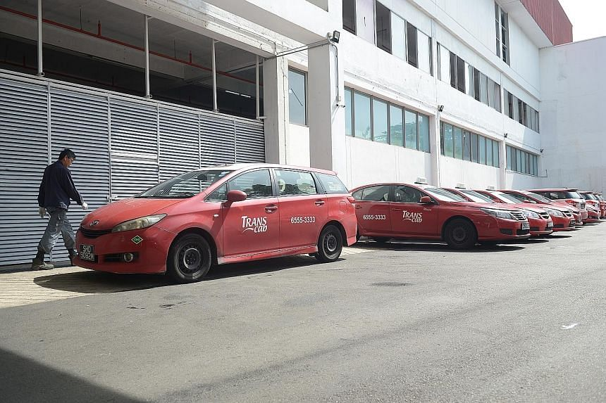 The last of Trans-Cab's CNG taxis to be taken off the road parked at the company's premises in Ang Mo Kio.
