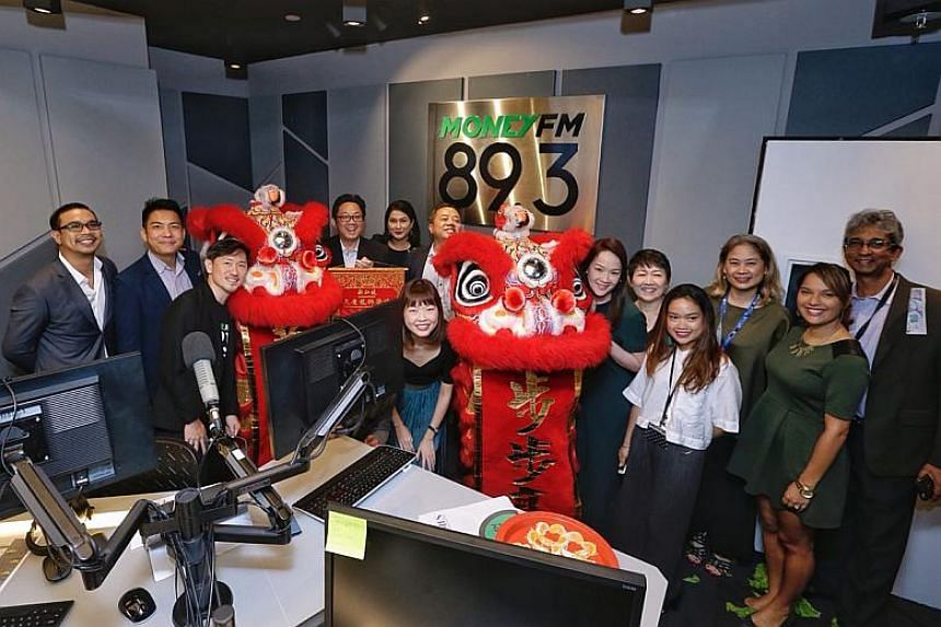 SPH chief executive Ng Yat Chung (fourth left) and deputy chief executive Anthony Tan (third left) taking a group picture with the MoneyFM 89.3 crew in the studio on Jan 29, 2018.