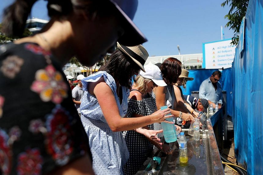 Tennis fans refilling their water bottles at a public facility during the Australian Open Grand Slam tennis tournament in Melbourne, Australia, on Jan 19, 2018.
