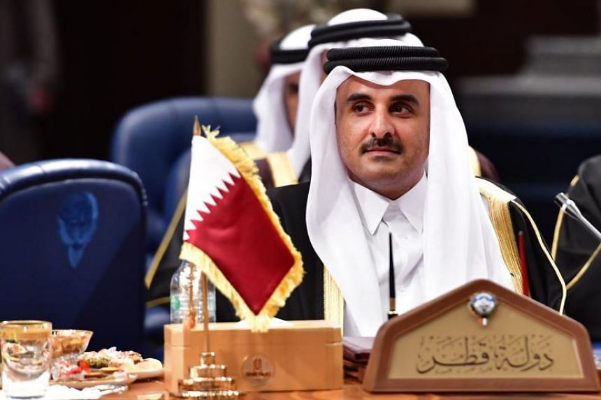 Qatar's Emir Sheikh Tamim bin Hamad al-Thani attends the Gulf Cooperation Council summit at Bayan palace in Kuwait City on Dec 5, 2017.