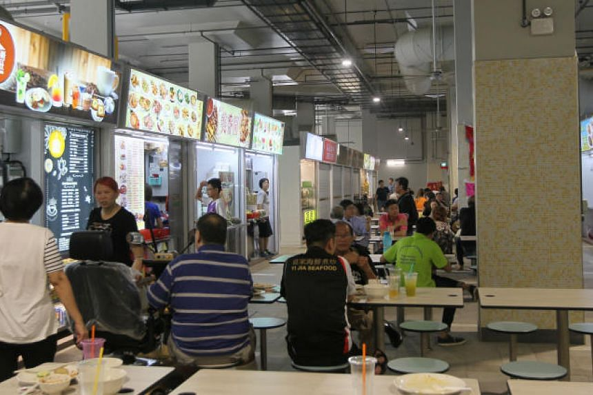 Hawkers who had to move to Marsiling Mall (pictured) from the old Woodlands Checkpoint said that business has been slower for them in their new location.