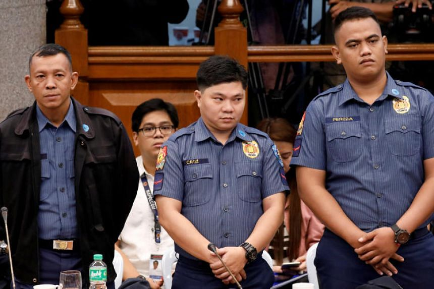 Police officers suspected of killing 17-year-old Kian delos Santos stand during a senate hearing in Pasay, Philippines, on Sept 5, 2017.
