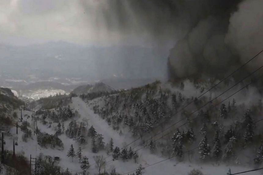 A photo captured by a gondola camera last Tuesday showing thick black smoke over the snow-covered Mt Kusatsu-Shirane volcano in Japan.