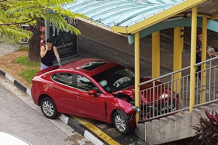 The red Mazda mounted the pavement and came to a stop at the foot of the overhead bridge in Jurong East Central last Friday. The 61-year-old driver was taken to hospital with minor injuries.