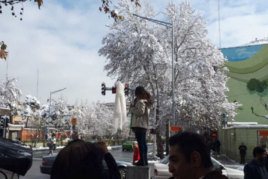 Narges Hosseini, whose age was not known, was jailed after posing in central Teheran on Monday without a headscarf.