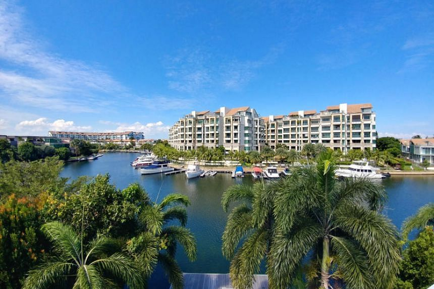 View of luxury homes along Sentosa Cove waterfront.