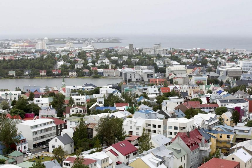 Multicolored rooftops and the harbour are seen on the city skyline in Reykjavik, Iceland.