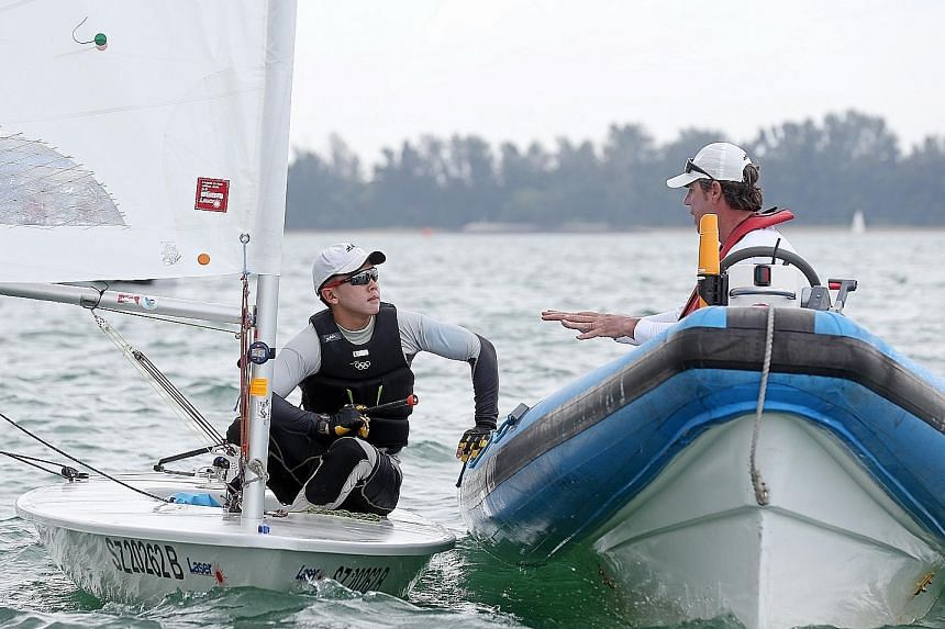 Singapore sailor Ryan Lo speaking to his coach, four-time Olympian Nenad Viali, after competing in an East Coast race. He intends to put his studies on hold after his national service ends in July, so that he can train full-time for the 2020 Olympics