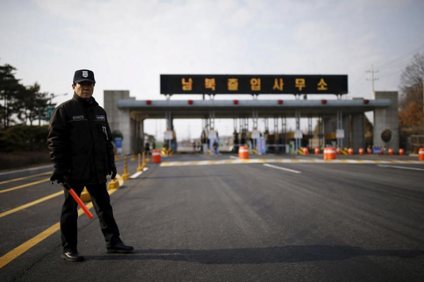 A South Korean security guard stands guard on an empty road which leads to the Kaesong Industrial Complex at the South's CIQ (Customs, Immigration and Quarantine), in Paju, South Korea, on Feb 11, 2016.