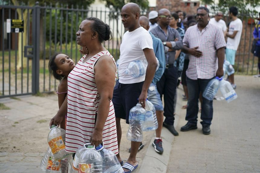 Residents line up to collect water from a spring in the Newlands area of Cape Town, South Africa, on Jan 22, 2018.