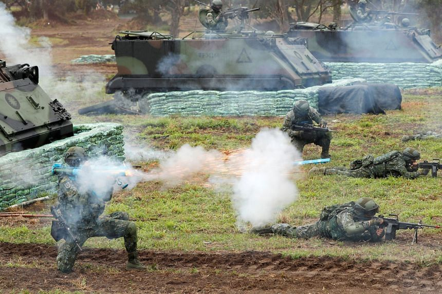 "Taiwanese soldiers taking part in the military drill yesterday, which saw tanks firing rounds as the ""enemy"" landed at the eastern port of Hualien."