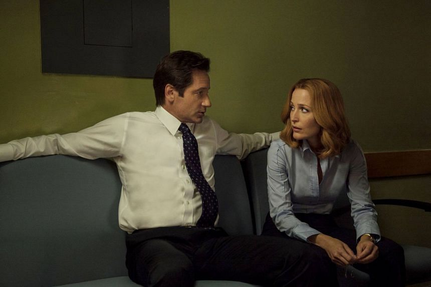 David Duchovny and Gillian Anderson star in science-fiction drama The X-Files. The 11th and current season of The X-Files explores how conspiracy theories have become loonier over the years, says writer-producer Darin Morgan.