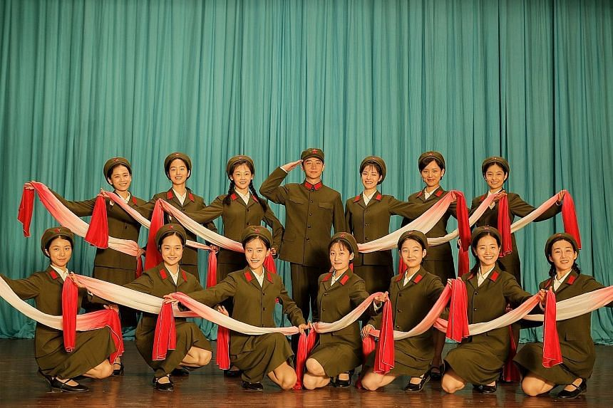 Youth centres on members of a People's Liberation Army arts troupe in the 1970s.