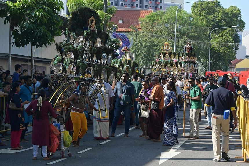 Devotees taking part in the Thaipusam festival yesterday. Many walked barefoot carrying milk pots and some carried kavadis from Sri Srinivasa Perumal Temple in Serangoon Road to Sri Thendayuthapani Temple in Tank Road.