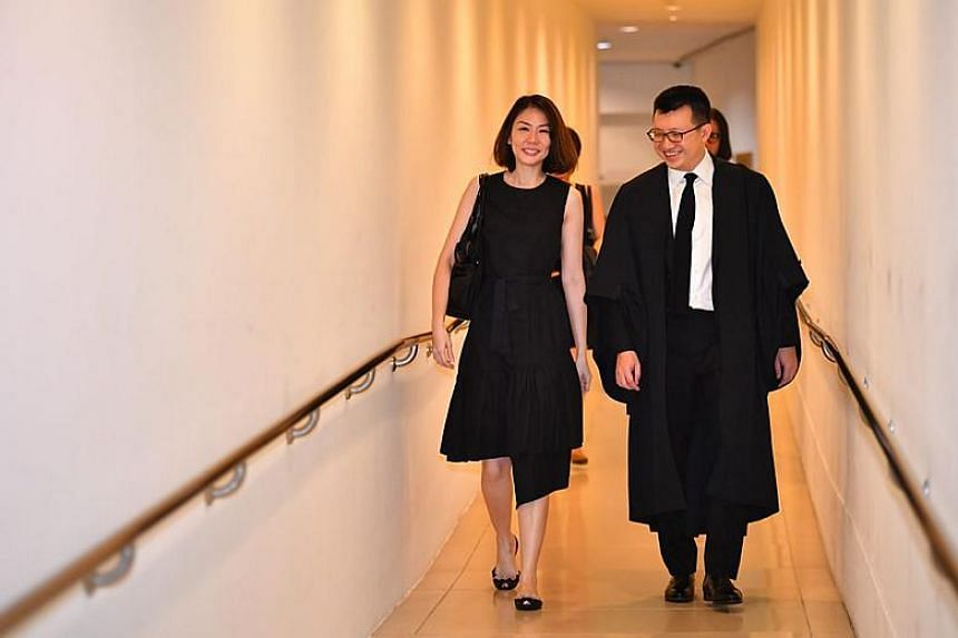 Former finance manager Sharon Tan walking out of the Supreme Court with her lawyer Paul Seah after the final verdict.