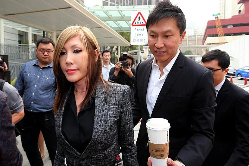 City Harvest Church founder Kong Hee and his wife Ho Yeow Sun arriving at the courts on Oct 21, 2015.