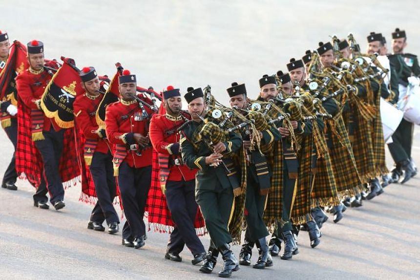 Members of an Indian armed forces band perform during the annual military ceremony Beating the Retreat at Rajpath, New Delhi, India, on Jan 29, 2018.