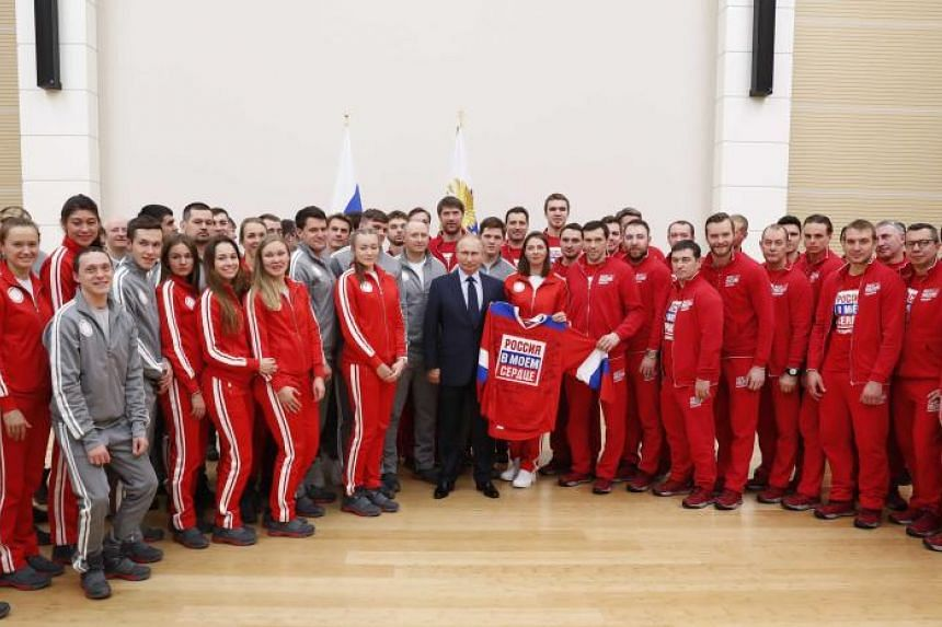 Russian President Vladimir Putin with Russian athletes and team members who will take part in the Pyeongchang Winter Olympic Games, at the Novo-Ogaryovo state residence outside Moscow on Jan 31.