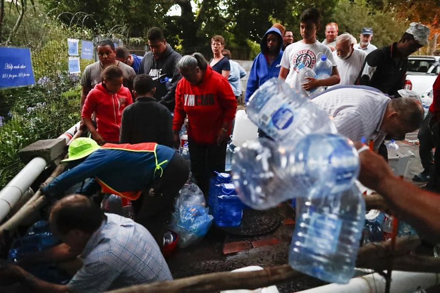 Residents collecting drinking water in the early morning from a mountain spring collection point in Cape Town, South Africa, on Jan 31, 2018.