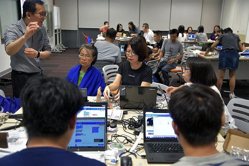 Participants attending a robotics workshop last October at the Lifelong Learning Festival, where the SkillsFuture Series was launched. The most popular course category among those using their SkillsFuture Credit last year was infocomm technology.