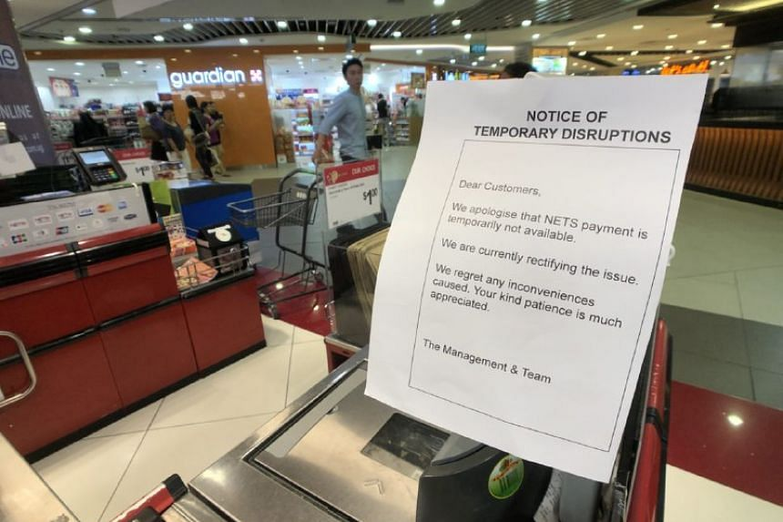 A notice at Cold Storage in Bugis Junction informing customers that Nets payments are unavailable.