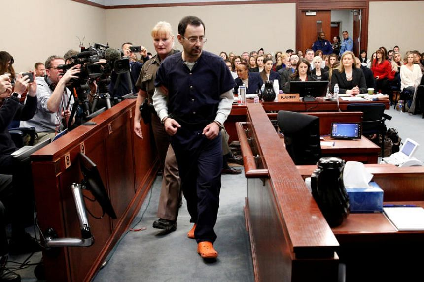 Larry Nassar, a former team USA Gymnastics doctor, is escorted into the courtroom during his sentencing hearing in Lansing, Michigan, US on Jan 24, 2018.