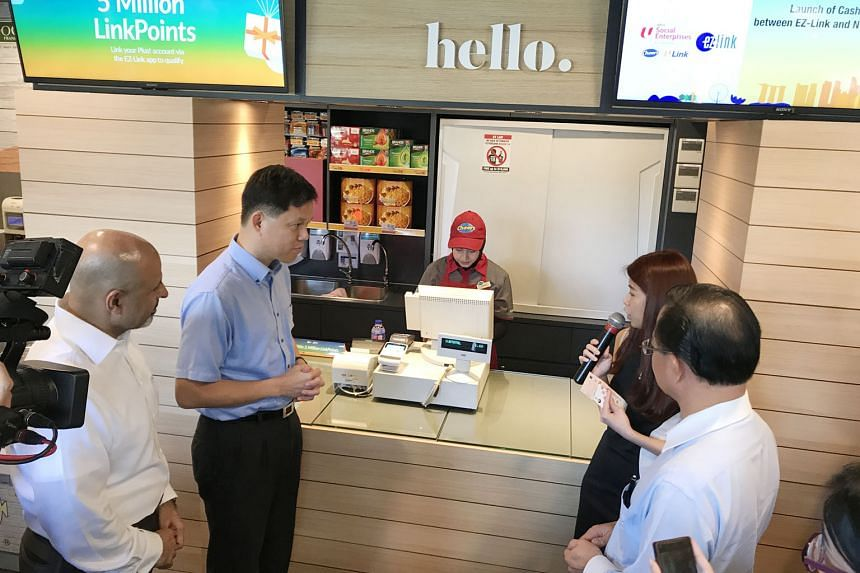 NTUC secretary-general Chan Chun Sing at the launch of the partnership between EZ-Link and NTUC Link at the Cheers convenience store at Tampines MRT station yesterday. In the second quarter of this year, Cheers customers can top up their ez-link card